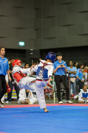 17 years: SURTTHANI, THAILAND - JULY 12: Unidentified Thai students 4 - 17 years old in action at suratthani taekwondo championship 2014 on July 12, 2014 in Suratthani, Thailand.