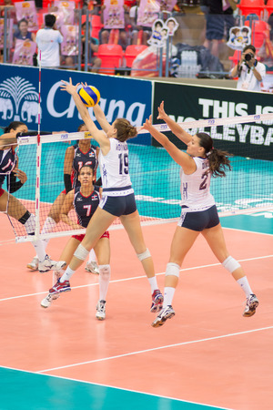 participate: Bangkok, Thailand - August 17:Unidentified volleyball players in action during Volleyball World Grand Prix 2014 at Indoor Stadium Huamark on August 17, 2014 in Bangkok, Thailand.
