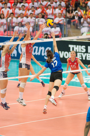 participate: Bangkok, Thailand - August 16:Unidentified volleyball players in action during Volleyball World Grand Prix 2014 at Indoor Stadium Huamark on August 16, 2014 in Bangkok, Thailand. Editorial