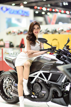 showed: Nonthaburi,Thailand - March 24th, 2015: Ducati booth with presenter ,showed in Thailand the 36th Bangkok International Motor Show on 24 March 2015 Editorial