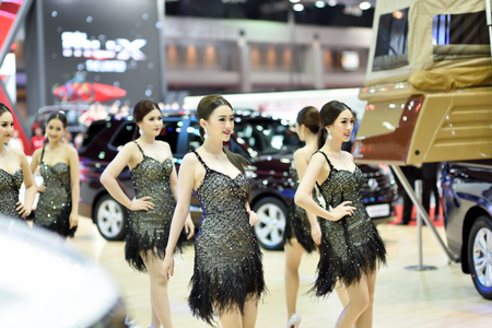 showed: Nonthaburi,Thailand - March 24th, 2015: Ssangyong booth with presenter ,showed in Thailand the 36th Bangkok International Motor Show on 24 March 2015