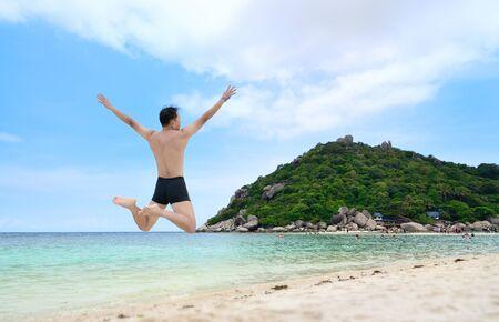 Happy traveler jumping on the beach, ko nangyuan, THAILAND. photo