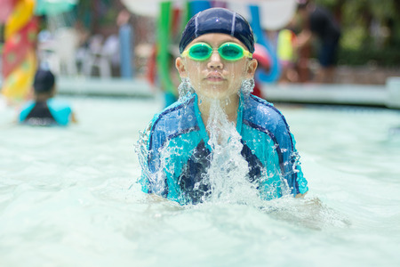 armbands: Asain kid in swimming pool.