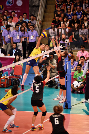 1 and group: Bangkok, Thailand - July 3-5 ,2015 : Group 1 women volleyball players in action in The 23rd edition of the FIVB Volleyball World Grand Prix at Hua Mak Sport Complex.