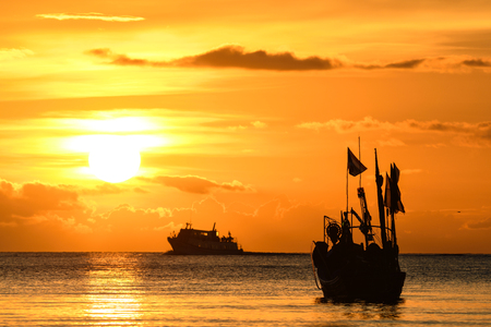 activity at sunset, ko samui, thailand.