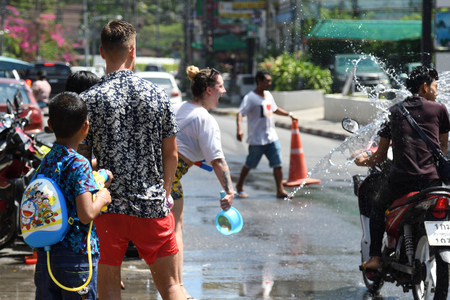KO SAMUI, THAILAND - APRIL 13: Foreigners and Thai people enjoy splashing water together in songkran festival on April 13, 2018 in Ko Samui island, Thailand.