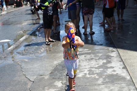 KO SAMUI, THAILAND - APRIL 13: Foreigners and Thai people enjoy splashing water together in songkran festival on April 13, 2018 in Ko Samui island, Thailand.
