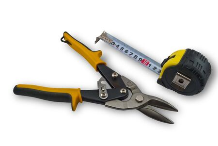 millimetre: The tape measure and wire-cutter  isolated on white background