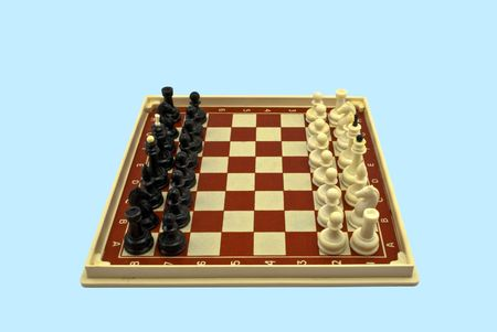 Chess-board with figures on a white background photo