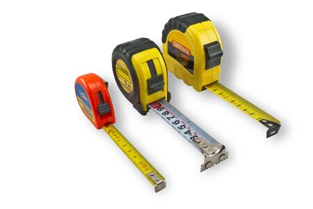 millimetre: Three different size tape measure on a white background