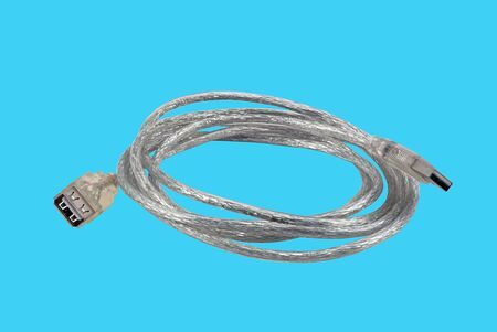 Usb cable on blue background Stock Photo - 7859337