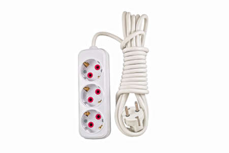 protector: A basic surge protector electric outlet isolated on black background Stock Photo