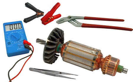 Electric motor rotor and tools for home electrical repair isolated white background photo