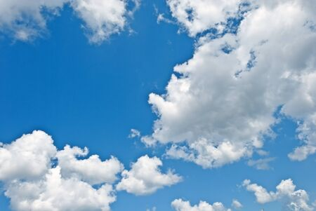 White clouds on a background blue sky photo