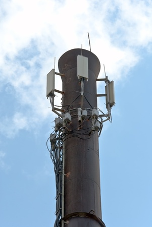 Power plant pipe with cellular aerials photo