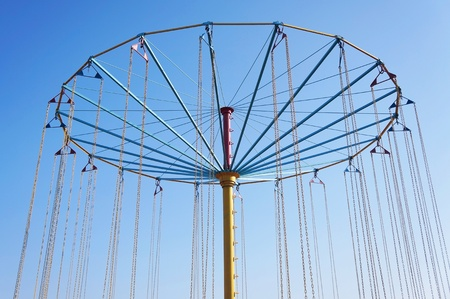 carousel on a background blue sky photo