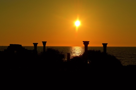 Sunset and pilars of ruins photo