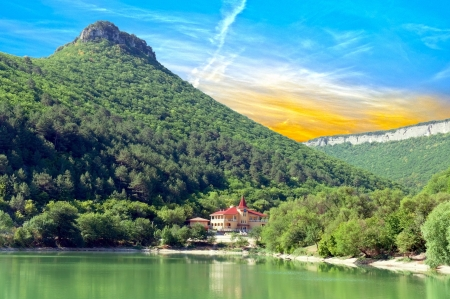 A house is ashore lake in the mountains of Crimea