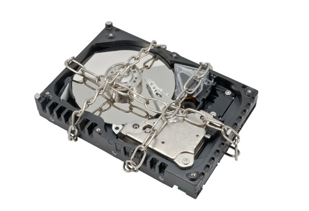 corrupt practice: Hard disk drive on chain isolated on white Stock Photo