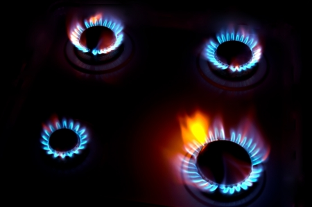energy suppliers: burning on a gas stove in the kitchen