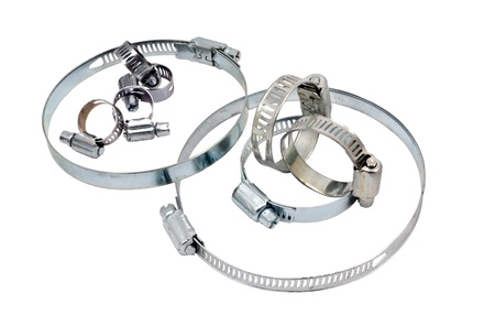 Closeup of Screw type or gear-driven hose clamps against white background  Reklamní fotografie