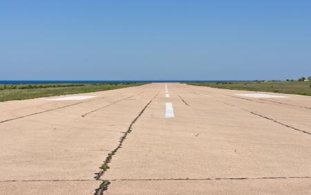 airport runway: old airport runway under blue sky
