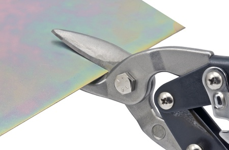 snip: Cutting steel stud with tin snip cutter Stock Photo