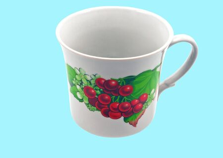 Tin Cup  isolated on a blue background  photo
