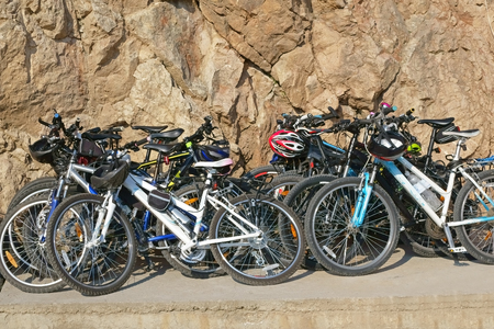leaned: bicycles are leaned to the lithoidal wall