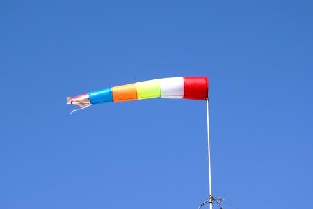 wind sleeve flying on a blue sky