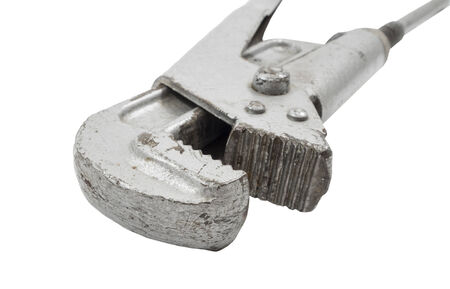 vintage pipe wrench isolated over a white background  photo