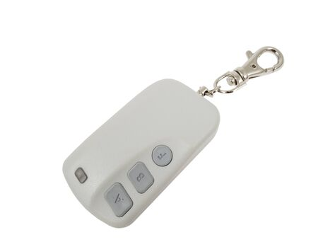 Car trinket and close up of the key ring  isolated on white  photo