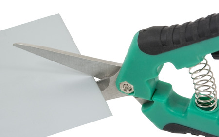 Cutting steel stud with tin snip cutter Stock Photo