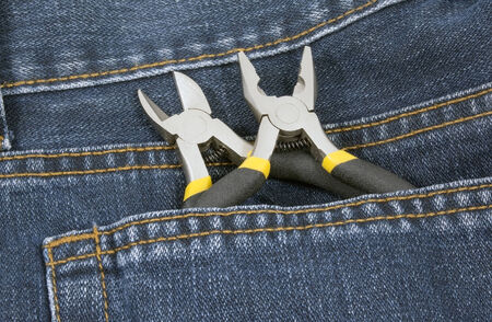 tools on a denim workers pocket photo
