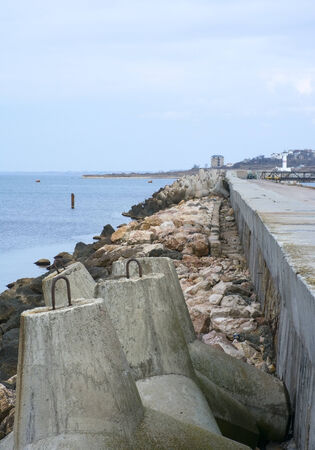 big breakwater on the sea photo
