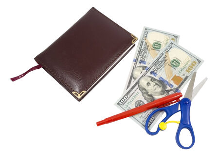 Notebook, pen, scissors and dollars on a white background photo