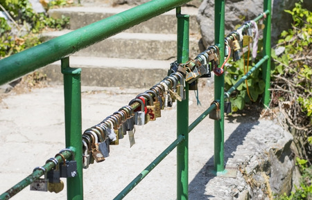 Many Love locks on the bridge  photo