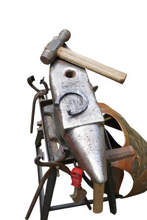 horseshoe and hammer isolated on a white photo