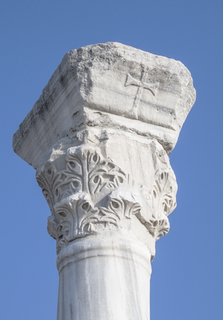 Greek column with the image of cross photo