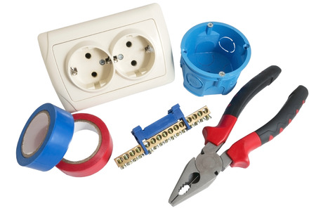 Electrician tools, cable, box for installation of sockets and disassembled outlet before installing