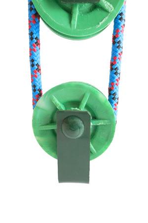 carrucole: due pulegge verdi su sfondo bianco