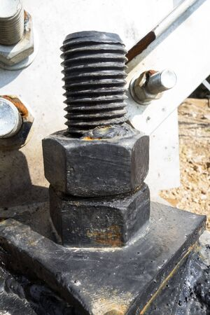 unsuitable: Big rusty metal nuts locked with rust and corrosion bolts