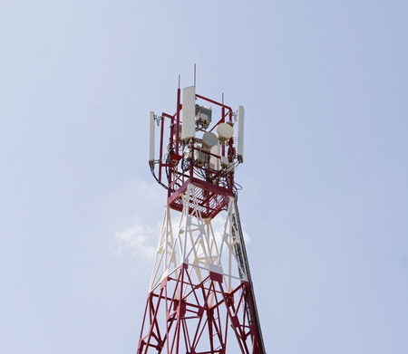 hertz: Tower with aerials of cellular on a background blue sky