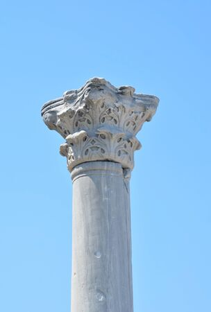 greek column: Greek column with the image of cross