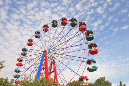 Ferris wheel in the summer morning Stock fotó