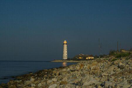 dramatics: Lighthouse on the coast of Black sea. Summer, Crimea. Stock Photo