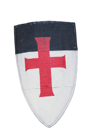 crusade: Old templar or crusader shield isolated on white