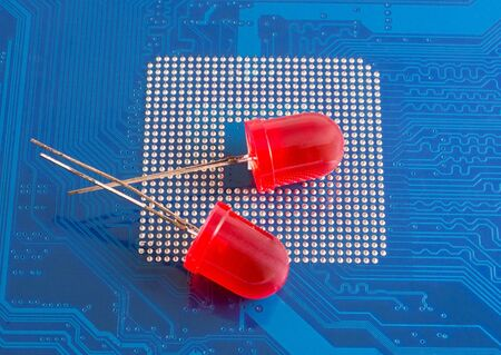 diodes: red led diodes on background computer motherboard Stock Photo