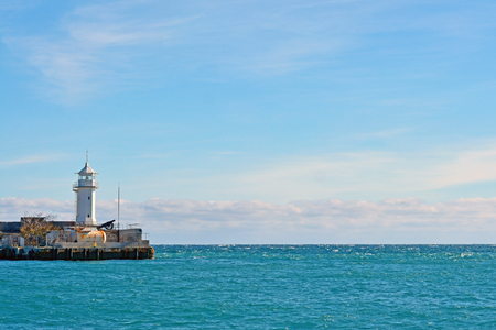 Sea embankment and lighthouse in Yalta