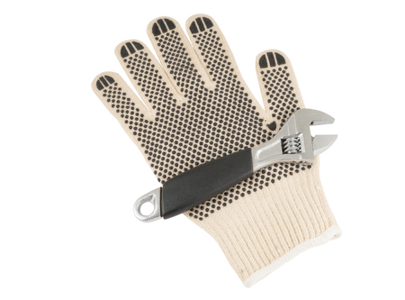 maintenance fitter: Adjustable spanner with leather glove on white background